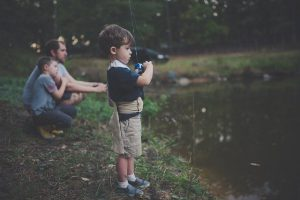 Boys fishing with their dad